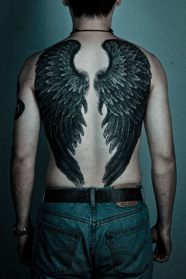 Wings tattoo on back for men