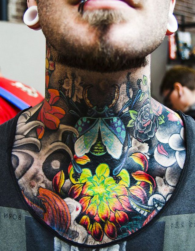 Neck tattoo designs for men mens neck tattoo ideas for Chest mural tattoos