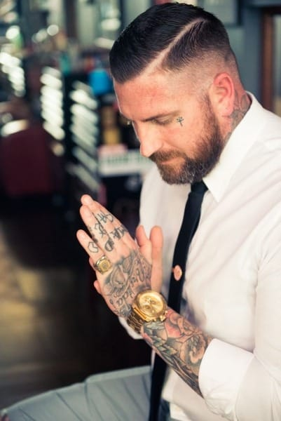 Face tattoos for men ideas and designs for guys for Cross tattoo under eye