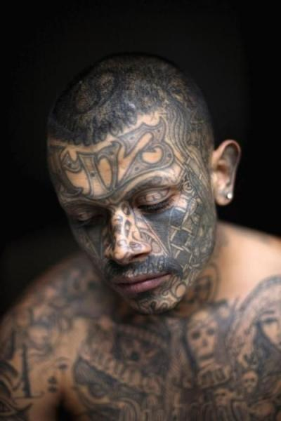 1a30ecc9c This black ink design is one of the coolest tattoo ideas for men who love  their ink. Covering the entire face, the intricate designs are sure to make  anyone ...