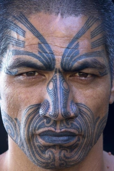5b91f1c32 This tribal tattoo is one of the best ideas for guys as the black ink  covers most of the face. Extending from the chin up to the forehead, it  leaves the ...