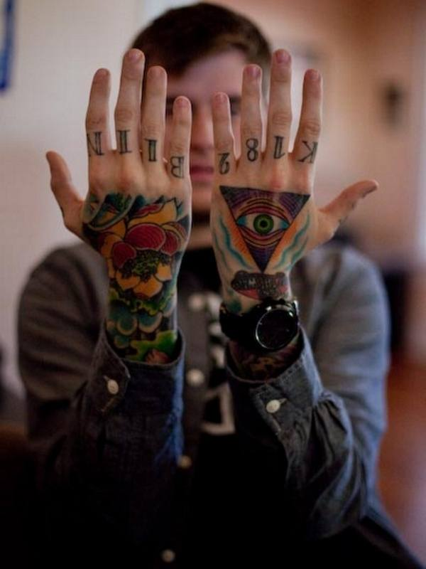 25df97f181106 The wonderful 3D tattoo is drawn on the entire upper arm to the fingers.  The whole hand tattoo is colored with different colors and the top hand  depicts the ...