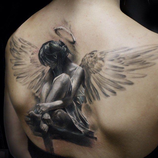 naked black angel tattoos