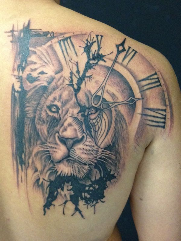 8a088f87782b5 This lion tattoo features Trash Polka tattoo style- that is, a contrast of  photo realistic and natural elements. A lion's head sits atop the right  pectoral ...