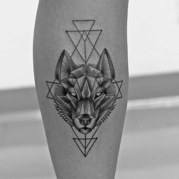 43f04e779b129 An intricate combination of triangular and quadrangular shapes, this one  offers a geometric take on the wolf tattoos for guys. It really is  fascinating how ...