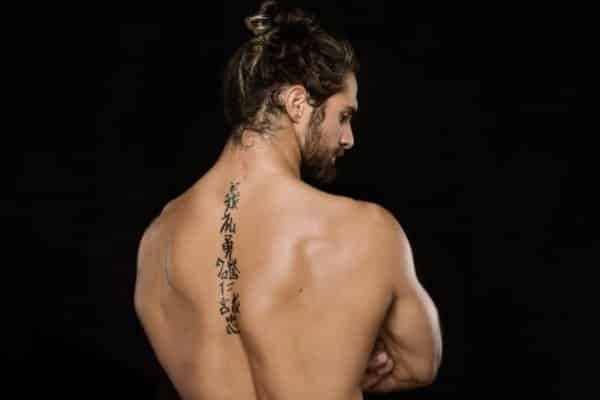 Spine tattoos for men ideas and designs for guys for Simple back tattoos for guys