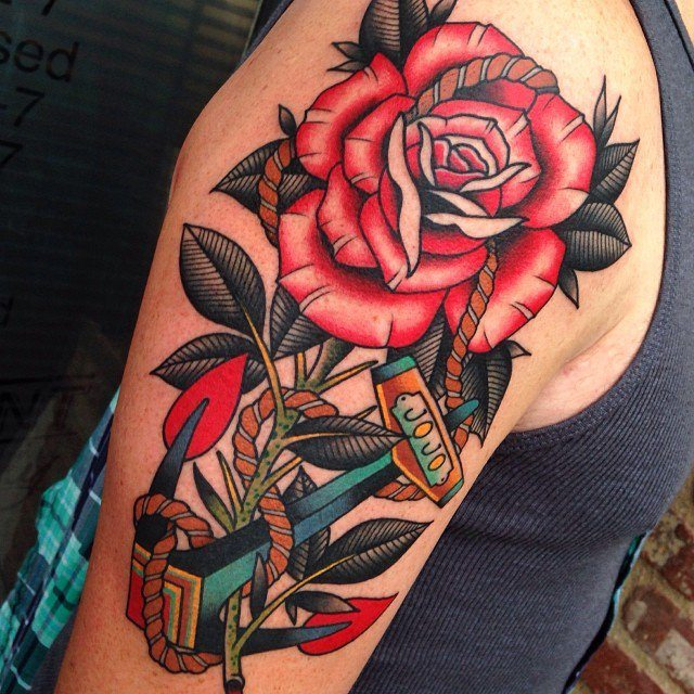c5f214653445d Roses are red, and vivid, vibrant, crisp, clear, and utterly attractive in  this amazing tattoo. Red and black tones dominate the picture featuring a  big ...