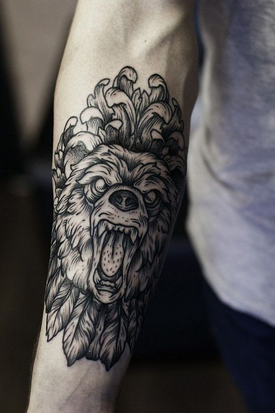 2cceb99ad Black and white bear tattoo on male forearm, fairly large in size and is  covering most of the forearm. Tattoo depicts the face of a roaring bear, ...