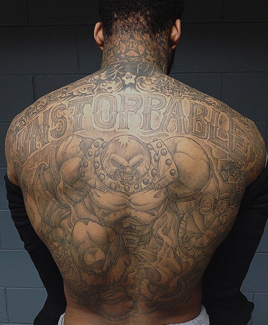Superhero tattoos for men ideas and inspiration for guys for Kyrie irving tattoos shoulder