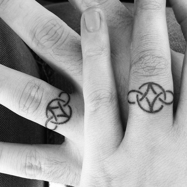 Wedding ring tattoos for men ideas and inspiration for guys for Interlocking wedding rings tattoo