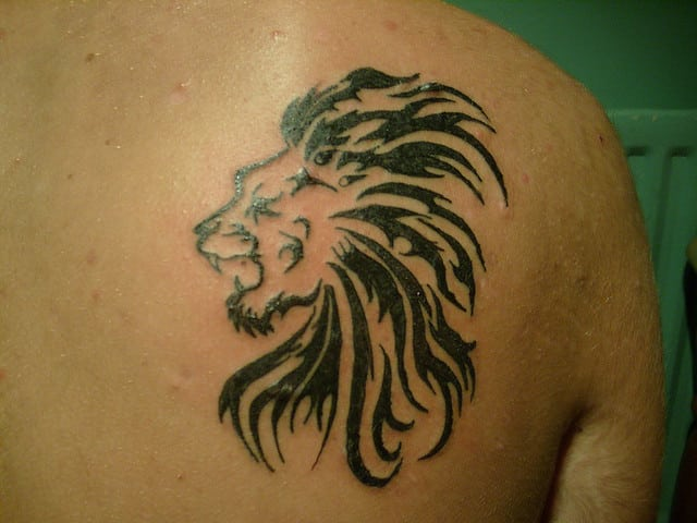 4d1731884 This tattoo is a different take on the otherwise front-facing lion face.  The design is somewhat abstract using cool symmetrical lines that are  simple and ...
