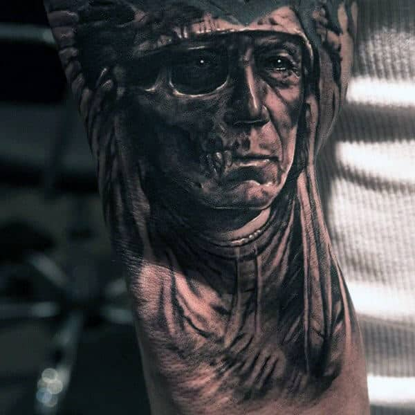 10a63c0e0 This upper arm tattoo is both symbolic and detailed to an almost  photographic level. The old Indian man's face is half alive and half dead –  to symbolize ...