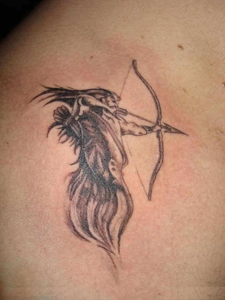 61b77cd9eaae1 In this tattoo Sagittarius is depicted as a fire-like character that  appears to emerge from a single flame rather than the traditional horse  body.