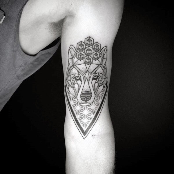 bdd0ceaf2 A stylized wolf becomes a shield when it's done in geometric relief. A nod  to cubism brings out the man-made feel in inner arm tattoos for guys.