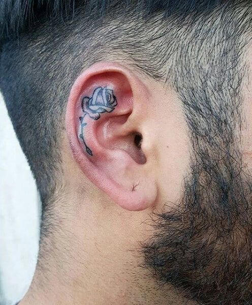 53604b724 You might despise it for being too small, but this tattoo makes it as one  of the best ear tattoos for guys.