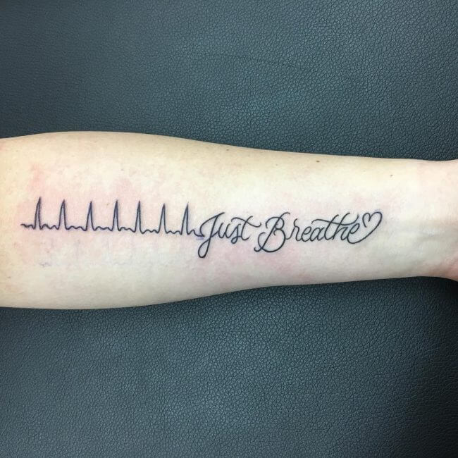 "0fc3174e4 Our simple but clear black tattoo design which starts with the beginning of  a heartbeat line and once it gets half way we are shown the words ""Just  Breath"" ..."